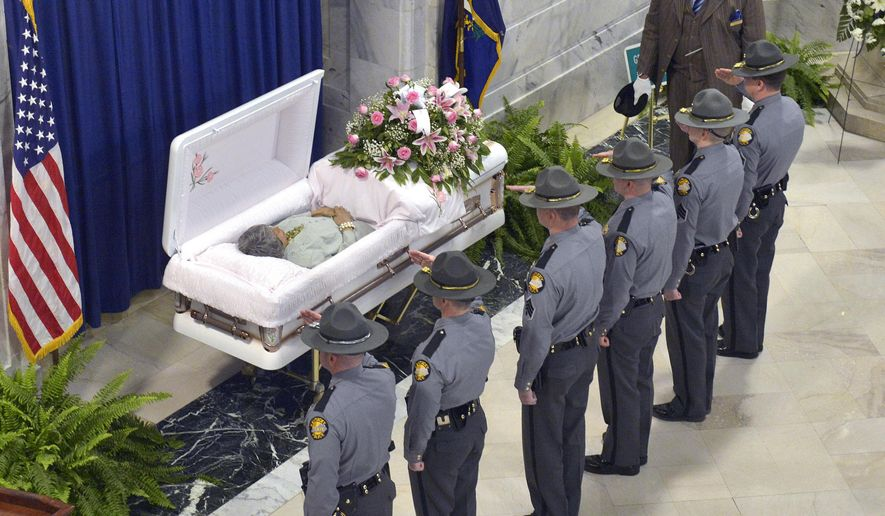 Kentucky State Troopers salute the remains of former Kentucky State Senator Georgia Davis Powers as she lies in state at the Kentucky State Capitol Thursday, Feb. 4, 2016, in Frankfort Ky. (AP Photo/Timothy D. Easley)