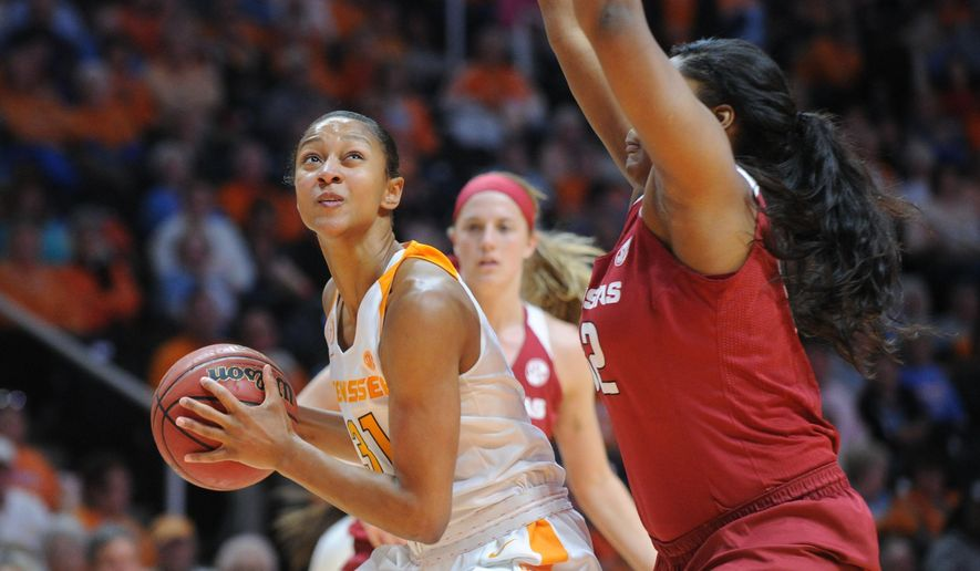 Tennessee guard/forward Jaime Nared (31), prepares to take a shot while defended by Arkansas forward Khadijah West (32) during the first half of a NCAA college basketball game on Thursday, Feb. 4, 2016, in Knoxville, Tenn. Tennessee defeated Arkansas 75-57. (Caitie McMekin/Knoxville News Sentinel via AP) MANDATORY CREDIT