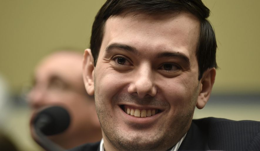 Pharmaceutical chief Martin Shkreli smiles on Capitol Hill in Washington, Thursday, Feb. 4, 2016, during the House Committee on Oversight and Reform Committee hearing on his former company's decision to raise the price of a lifesaving medicine. Shkreli refused to testify before U.S. lawmakers who excoriated him over severe hikes for a drug sold by a company that he acquired. (AP Photo/Susan Walsh) ** FILE **