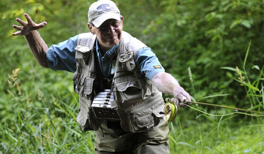 "In this June 30, 2010 photo, Joe Humphreys releases the line while using his rod like a bow to place the fly exactly where he wants it in the stream, outside of Spruce Creek, Pa. Humphreys is a renowned fly fisherman from State College, Pa., and a subject of a documentary film ""Live the Stream,"" by  Lucas and Meigan Bell.  (Nabil K. Mark/Centre Daily Times via AP) MANDATORY CREDIT; MAGS OUT"