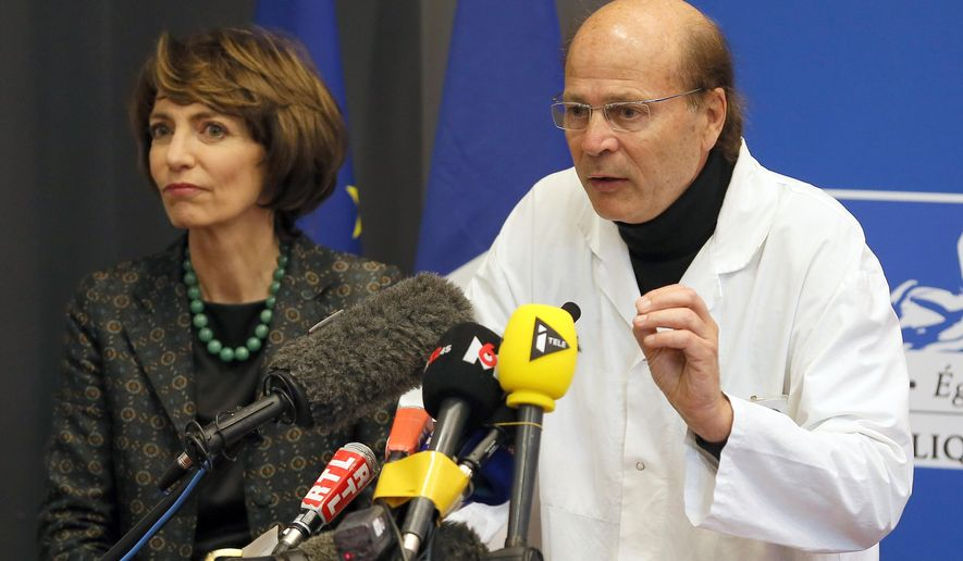 FILE - In this Jan.15, 2016 file photo, French Health Minister Marisol Touraine, left, and Professor Gilles Edan, the chief neuroscientist at Rennes Hospital, address the media during a press conference in Rennes, western France. France's health minister releases a report on what went wrong during a drug trial for a painkiller that left one man dead and several people hospitalized. (AP Photo/David Vincent, File)