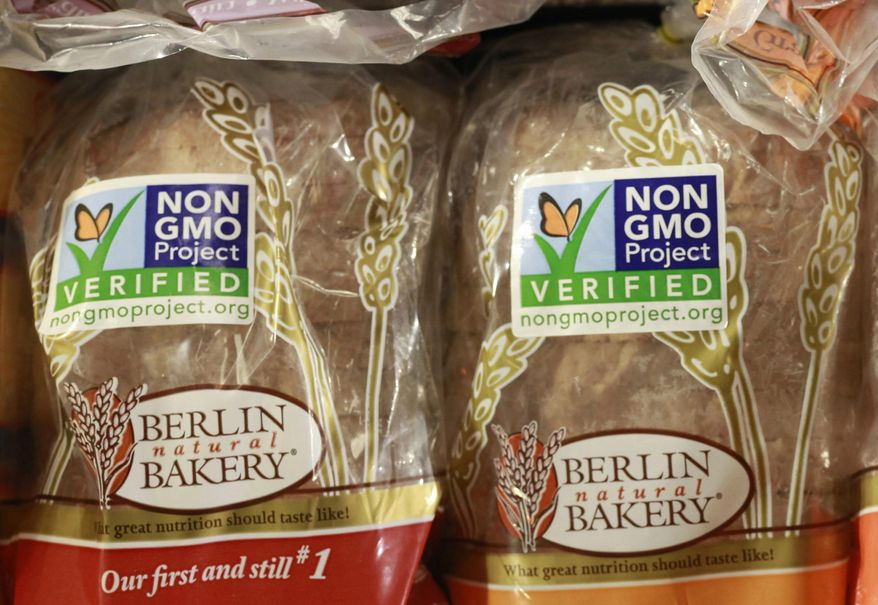 Products labeled with Non Genetically Modified Organism (GMO) are sold at the Lassens Natural Foods & Vitamins store in Los Feliz district of Los Angeles. The food industry is pressuring Congress to act before the state of Vermont requires food labels for genetically modified ingredients. (AP Photo/Damian Dovarganes, File)