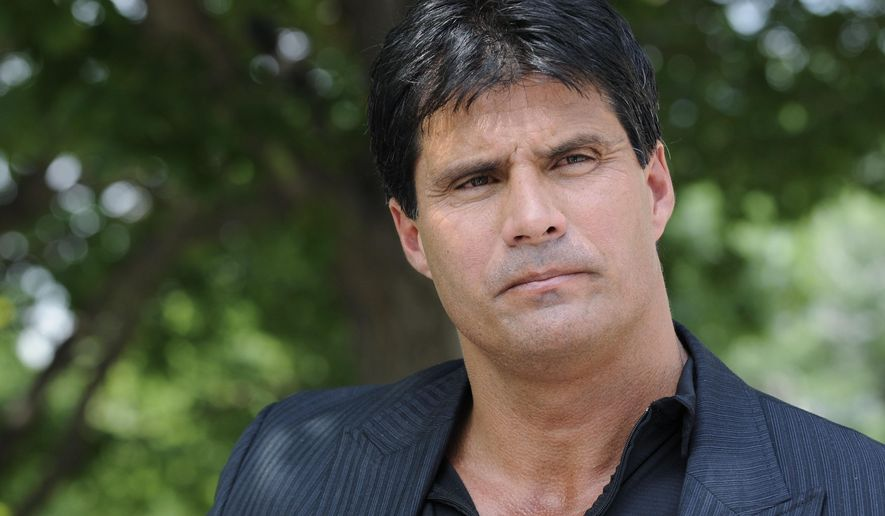 This June 3, 2010, file photo shows Jose Canseco talking with reporters in Washington. (AP Photo/Susan Walsh, File)