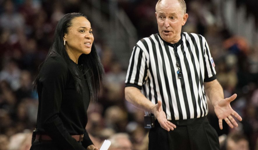 South Carolina head coach Dawn Staley, left, talks with an official during the first half of an NCAA college basketball game against Kentucky Thursday, Feb. 4, 2016, in Columbia, S.C. (AP Photo/Sean Rayford)