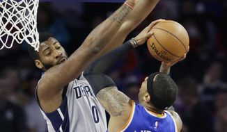 New York Knicks forward Carmelo Anthony (7) shoots over the defense of Detroit Pistons center Andre Drummond (0) during the first half of an NBA basketball game, Thursday, Feb. 4, 2016 in Auburn Hills, Mich. (AP Photo/Carlos Osorio)