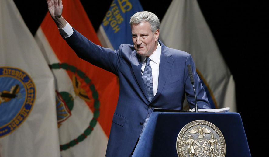 New York Mayor Bill de Blasio  waves upon arriving on stage for his State of the City address, Thursday, Feb. 4, 2016, at Lehman College in the Bronx borough of New York.  (AP Photo/Kathy Willens)