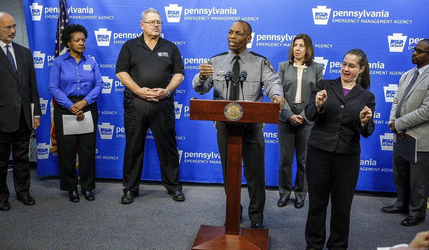 FILE - In this Jan. 21, 2016, file photo, Pennsylvania State Police Commissioner Col. Tyree Blocker, standing at the podium, discusses snowstorm preparations at the Pennsylvania Emergency Management Agency's headquarters in Susquehanna Township, Pa. In a statement issued Thursday, Feb. 4, 2016, Blocker said an investigation into possible cheating at the Pennsylvania State Police academy has involved dozens of interviews and extensive collection of evidence since the probe began in December. (Dan Gleiter/PennLive.com via AP, File) MANDATORY CREDIT