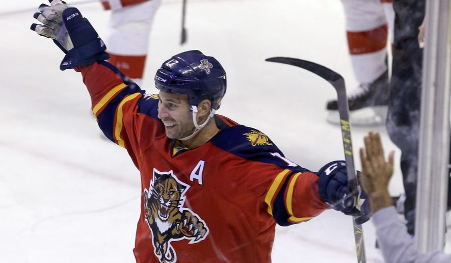 Florida Panthers center Derek MacKenzie (17) celebrates after scoring against the Detroit Red Wings during the second period of an NHL hockey game, Thursday, Feb. 4, 2016, Sunrise, Fla. (AP Photo/Alan Diaz)