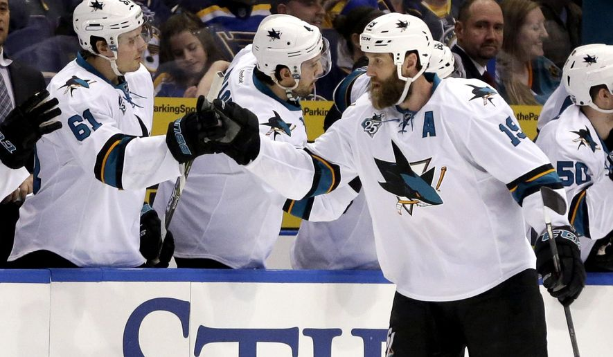 San Jose Sharks' Joe Thornton, right, is congratulated by teammate Justin Braun (61) after scoring during the second period of an NHL hockey game against the St. Louis Blues on Thursday, Feb. 4, 2016, in St. Louis. (AP Photo/Jeff Roberson)