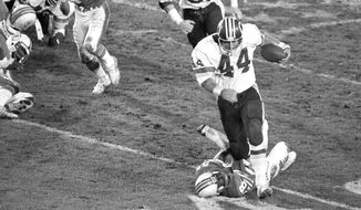 FILE- In this Jan. 30, 1983, file photo, Washington Redskins running back John Riggins (44) breaks away from Miami Dolphins cornerback Don McNeal on his way to the game-winning touchdown during the fourth quarter of Super Bowl XVII in Pasadena, Calif. The Redskins defeated the Dolphins 27-17. Riggins rushed for 166 yards and was named Most Valuable Player of the game. (AP Photo/File)