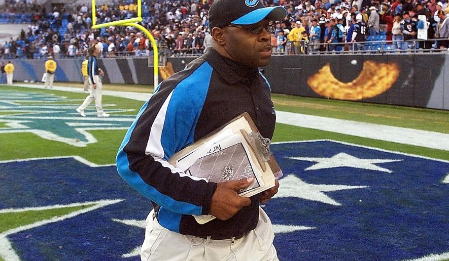 """FILE - In this Nov. 16, 2003, file photo, Carolina Panthers linebackers coach Sam Mills leaves the field after the Panthers' game against the Washington Redskins in Charlotte, N.C. The Panthers motto is everywhere, on stadium walls, plaques and even the team jerseys: """"Keep Pounding."""" The advice comes from Mills, a Panthers linebacker who died of intestinal cancer and is honored with a statue outside the team's stadium.  (AP Photo/Rick Havner, File)"""