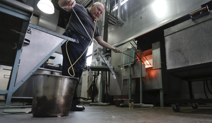 In this Friday, Jan. 22, 2016 photo, glassblower William Gudenrath makes a goblet with techniques used by Renaissance Venetians at the Corning Museum of Glass in Corning, N.Y. Gudenrath spent decades researching how Renaissance-era glassmakers produced objects that are now considered works of art.  (AP Photo/Mike Groll)