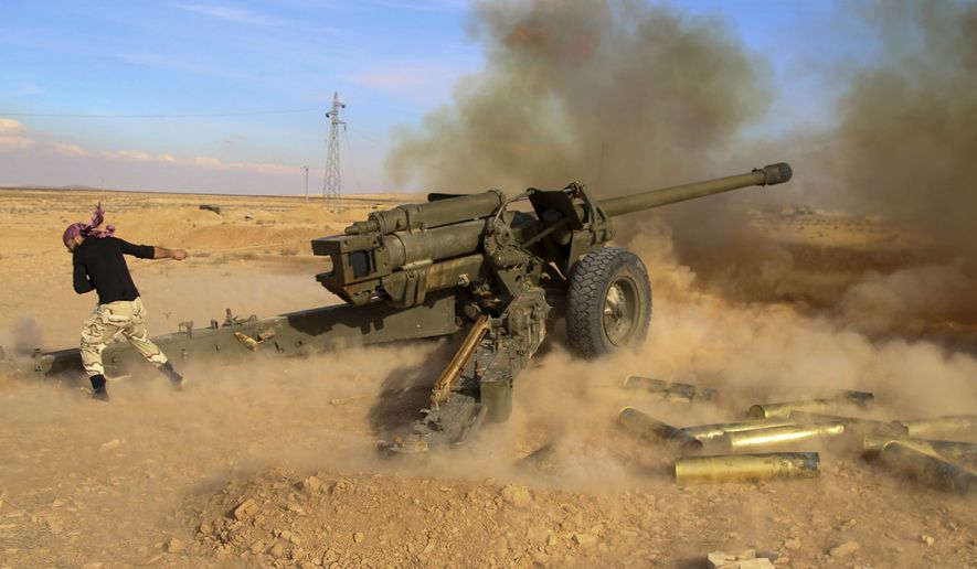 In this photo taken on Saturday, Jan. 30, 2016, Syrian government troops fire at Islamic State group positions near Mahin, Syria. The nearly five-year Syrian conflict has left at least 250,000 people dead, forced millions to flee the country and given an opening to the Islamic State group to capture territory in Syria and Iraq. It has drawn in U.S. and Russia, as well as regional powers such as Turkey, Saudi Arabia and Iran. (Alexander Kots/Komsomolskaya Pravda via AP)