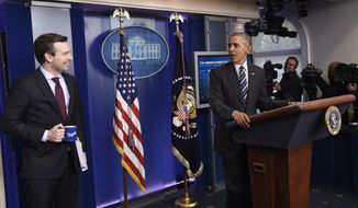 President Barack Obama looks toward White House press secretary Josh Earnest in the Brady Press Briefing Room of the White House in Washington, Friday, Feb. 5, 2016, during a news conference on the economy.  (AP Photo/Susan Walsh)