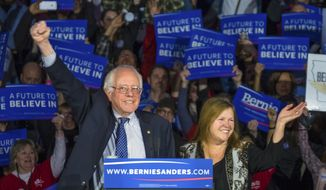 Democratic presidential candidate, Sen. Bernie Sanders, I-Vt,  and his wave Jane acknowledge the crowd as he arrives for his caucus night rally in Des Moines, Iowa, Monday, Feb. 2, 2016.  (AP Photo/J. David Ake)