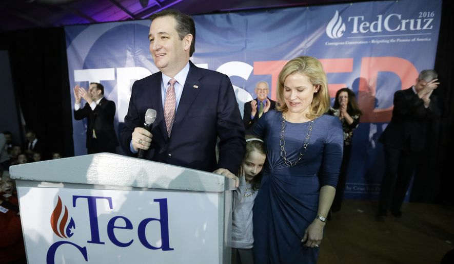 Republican presidential candidate, Sen. Ted Cruz, R-Texas, speaks at caucus night rally with Heidi, and their daughter Caroline, 7, Monday, Feb. 1, 2016, in Des Moines, Iowa. (AP Photo/Charlie Neibergall) ** FILE **