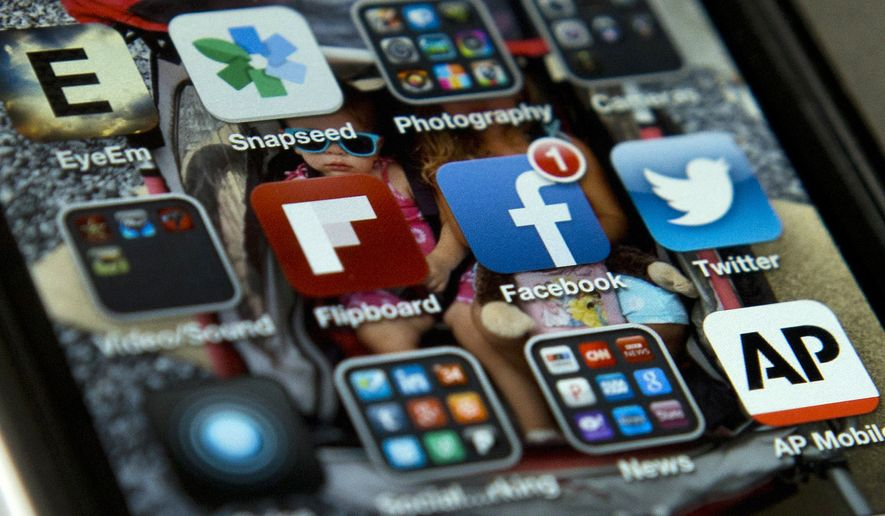A view of an iPhone in Washington shows Twitter among other apps on May 21, 2013. Twitter is now using spam-fighting technology to seek out accounts that might be promoting terrorist activity and is proactively looking at other accounts related to those flagged for possible removal, the company announced Feb. 5, 2016. (Associated Press) **FILE**