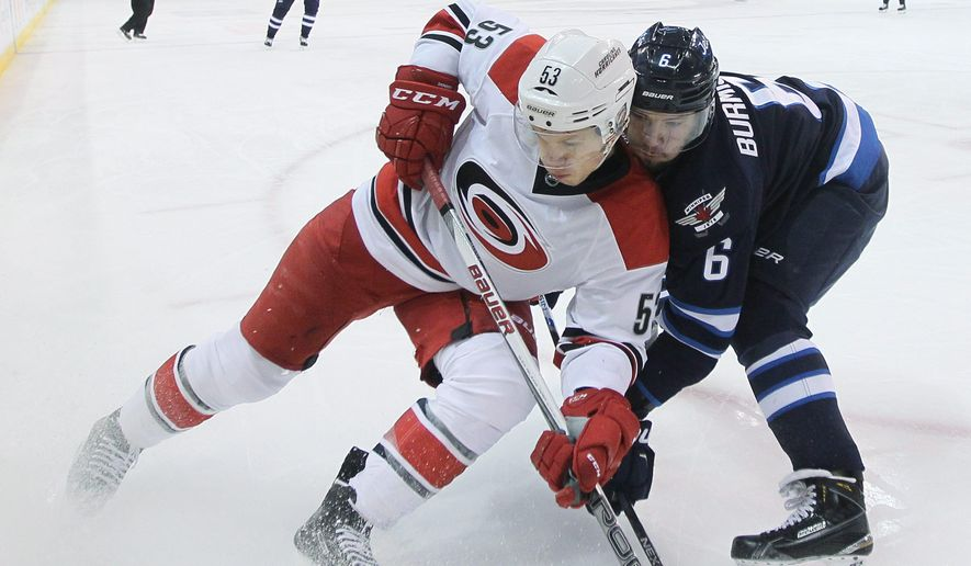 Carolina Hurricanes' Jeff Skinner (53) and Winnipeg Jets' Alex Burmistrov (6) go into the corner for the puck during the second period of an NHL hockey game Friday, Feb. 5, 2016, in Winnipeg, Manitoba. (John Woods/The Canadian Press via AP)