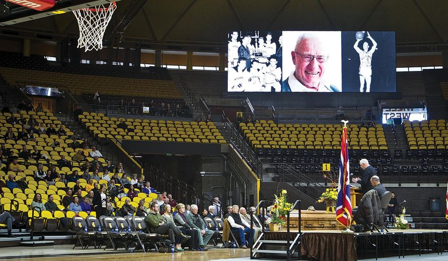 A eulogy written by Dan Sailors is read by Bill Schrage as friends and family gather during the funeral of Kenny Sailors, Friday, Feb. 5, 2016 at the University of Wyoming Arena-Auditorium in Laramie, Wyo. (Jeremy Martin/Laramie Daily Boomerang via AP) MANDATORY CREDIT