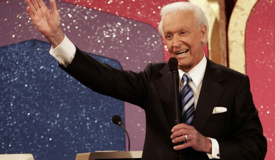 """FILE - In this June 6, 2007 file photo, legendary game show host Bob Barker waves goodbye as he tapes his final episode of """"The Price Is Right"""" in Los Angeles. Barker will return to a Texas military installation where he became a Navy fighter pilot to help celebrate its 75th anniversary. Naval Air Station Corpus Christi announced the 92-year-old Barker will be the guest speaker at its March 12, 2016, celebration.  (AP Photo/Damian Dovarganes, File)"""