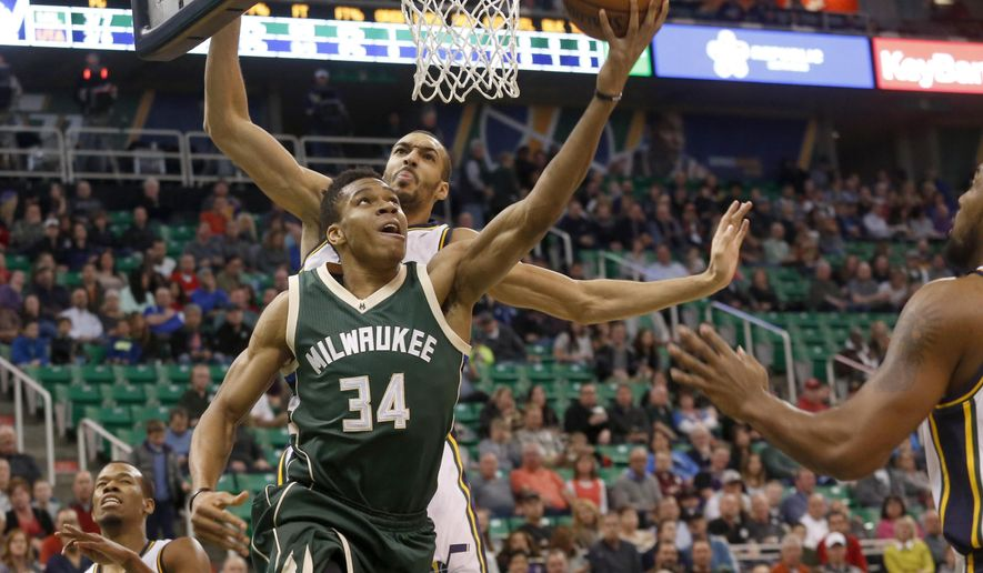 Milwaukee Bucks' Giannis Antetokounmpo (34) attempts a layup as Utah Jazz's Rudy Gobert, back, defends during the first half of an NBA basketball game Friday, Feb. 5, 2016, in Salt Lake City. (AP Photo/Kim Raff)
