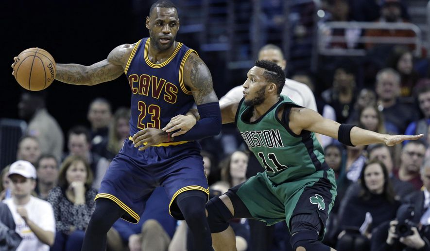 Cleveland Cavaliers' LeBron James (23) drives past Boston Celtics' Evan Turner (11) in the first half of an NBA basketball game Friday, Feb. 5, 2016, in Cleveland. (AP Photo/Tony Dejak)