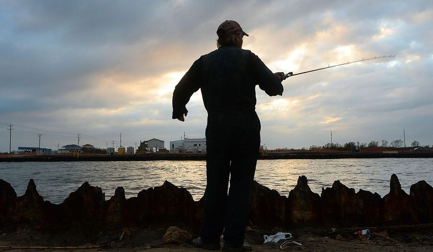 "This photo taken Jan. 20, 2016, shows Rick Waynick, or ""Rollover Rick"" as he is known among the regulars who fish at Rollover Pass in the Bolivar Peninsula, getting in some late day fishing before sundown Wednesday. Waynick has been fishing at the popular waterway between the Gulf and East Bay for 30 years and has a number of reasons why he believes the pass should remain open. The Galveston County Commissioners Court recently voted to close Rollover Pass, which is part of the land owned by the Galveston Rod, Reel, and Gun Club. After sealing the connecting waterway, plans may be to build a state or county park with fishing piers extending out into the Gulf. (Kim Brent/The Beaumont Enterprise via AP)"