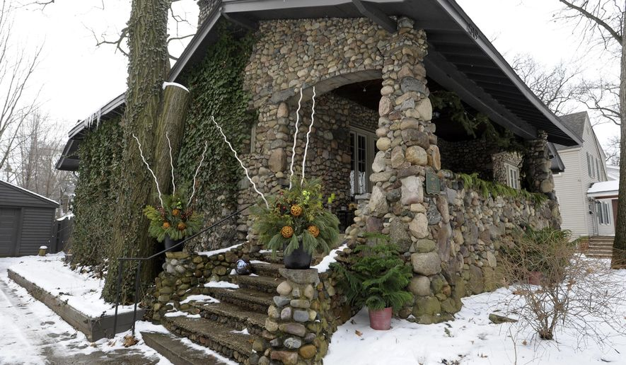 This Friday, Jan. 15, 2016 photo shows the 1920s Craftsman-style stone bungalow in Ferndale, Mich., owned by Evan Derian and Tamela Ekstrom. (Todd McInturf/The Detroit News via AP)