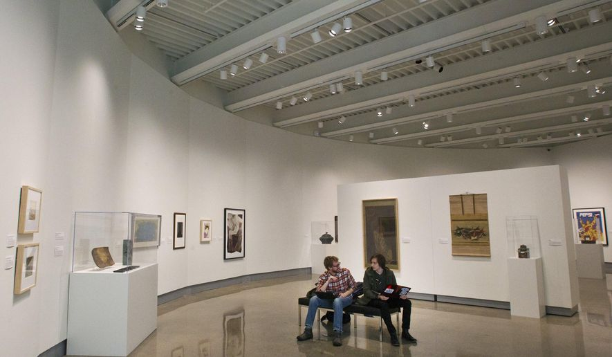 "In this photo taken on Tuesday, Jan. 19, 2016, Hope senior Kevin Wennersten, left, and sophomore Mason Hunt sit inside Hope College's new Kruizenga Art Museum in Holland, Mich. ""It's a great place to be,"" said Hunt. ""Before this museum was built, people didn't have the opportunity to see much of Hope's collection,"" said Wennersten. The $7 million museum will feature the school's permanent art collection, visiting exhibitions, and space for educational events. The project was completed by G.O. Construction, a joint venture of GDK Construction, of Holland, and Owen-Ames-Kimball Co. (O-A-K), of Grand Rapids. (Cory Morse/The Grand Rapids Press via AP) ALL LOCAL TELEVISION OUT; LOCAL TELEVISION INTERNET OUT; MANDATORY CREDIT"
