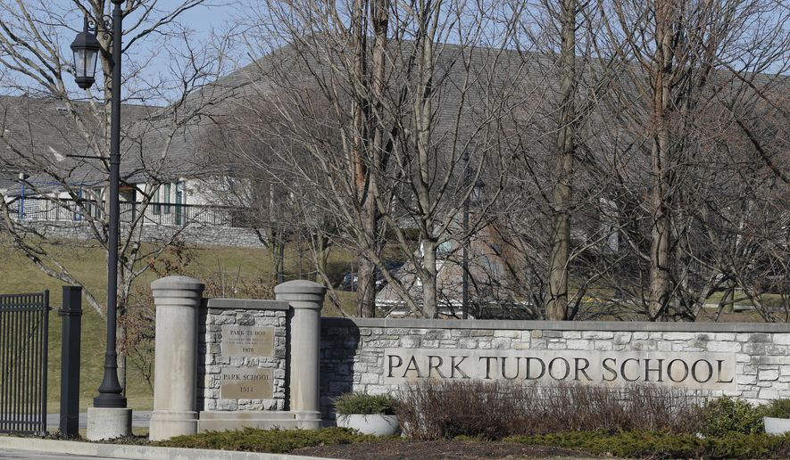 The entrance to Park Tutor High School is shown Friday, Feb. 5, 2016, in Indianapolis. Federal prosecutors have charged the former boys basketball coach at the exclusive private school with trying to entice a 15-year-old female student into a sexual relationship. Prosecutors filed the charges Thursday against former Park Tudor coach Kyle Cox, who resigned Dec. 15. (AP Photo/Michael Conroy)