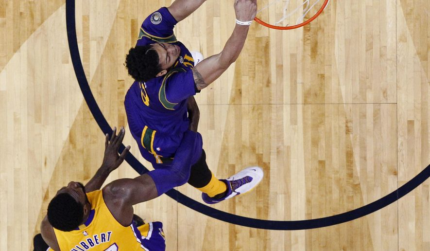 New Orleans Pelicans forward Anthony Davis (23) slam dunks ahead of Los Angeles Lakers center Roy Hibbert (17) in the first half of an NBA basketball game in New Orleans, Thursday, Feb. 4, 2016. (AP Photo/Gerald Herbert)