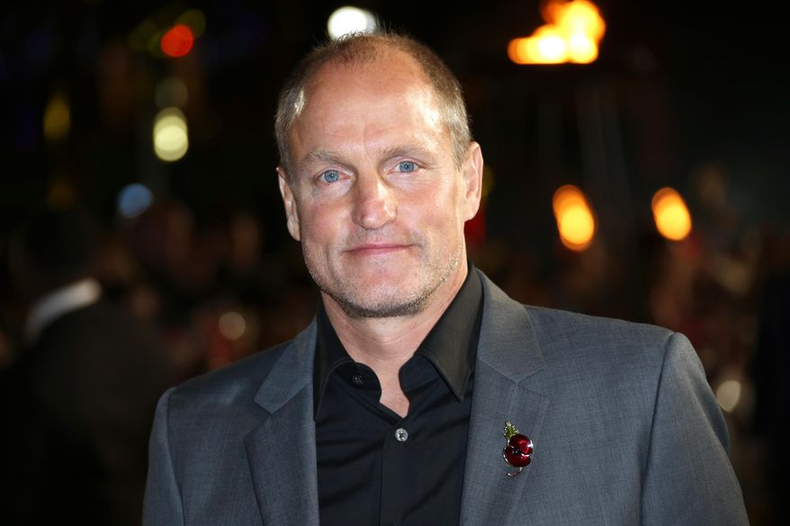 """In a Thursday, Nov. 5, 2015, file photo, Woody Harrelson poses for photographers upon arrival at the premiere of the film """"The Hunger Games Mockingjay Part 2,"""" in London. (Photo by Joel Ryan/Invision/AP, File)"""