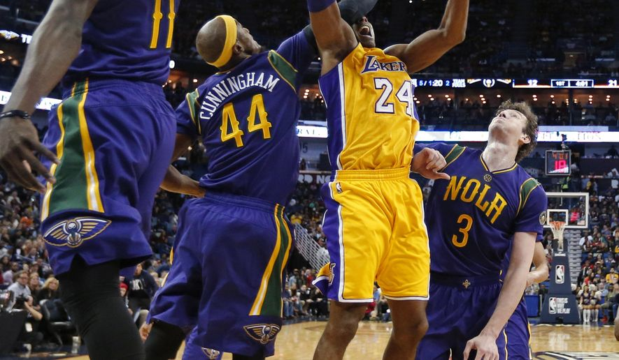 Los Angeles Lakers forward Kobe Bryant (24) goes to the basket between New Orleans Pelicans guard Jrue Holiday (11), forward Dante Cunningham (44) and center Omer Asik (3) in the first half of an NBA basketball game in New Orleans, Thursday, Feb. 4, 2016. (AP Photo/Gerald Herbert)