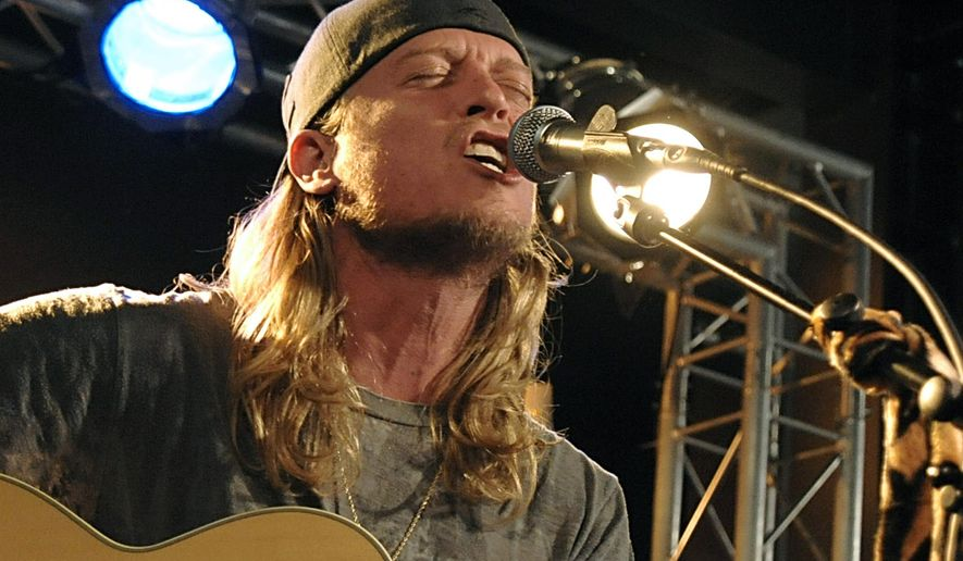 FILE - In this Dec. 7, 2009 file photo, singer Wes Scantlin of the band Puddle of Mudd performs at the Gibson Guitar Dusk Tiger launch party in Beverly Hills, Calif. Scantlin pleaded not guilty to a felony vandalism charge on Friday Feb. 5, 2016, filed after the singer's arrest last month at a home he once owned that he recently lost in foreclosure. (AP Photo/Dan Steinberg, File)
