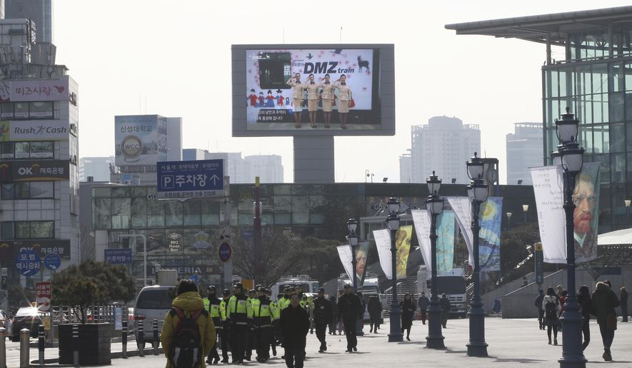 A screen advertising a demilitarized zone (DMZ) train tour is displayed near Seoul Railway Station in Seoul, South Korea, Friday, Feb. 5, 2016. Another big North Korea news story, another collective yawn from South Koreans. Many in the South either don't know or don't care about their rival's declared plan to launch a rocket this month that the world sees as a banned test of a ballistic missile that could hit the United States. (AP Photo/Ahn Young-joon)