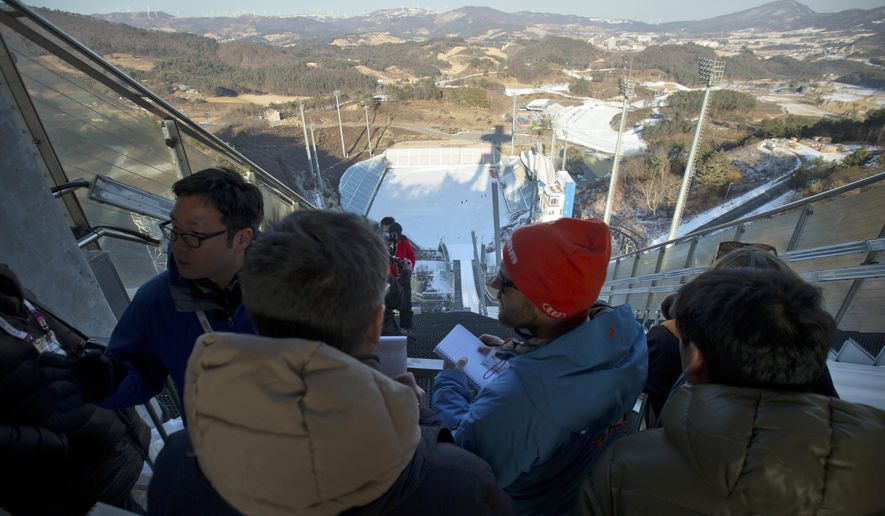 Visitors look at the Alpensia Ski Jumping Center during a media tour in Pyeongchang, South Korea, Friday, Feb. 5, 2016. Officials held a media tour on Friday of venues for the upcoming 2018 Pyeongchang Winter Olympics, ahead of a World Cup skiing event this weekend that will be the first test event for the 2018 Games. (AP Photo/Mark Schiefelbein)