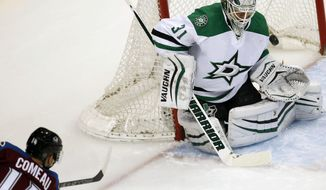 Colorado Avalanche left wing Blake Comeau, left, scores a goal past Dallas Stars goalie Antti Niemi, of Finland, in the first period of an NHL hockey game Thursday, Feb. 4, 2016, in Denver. (AP Photo/David Zalubowski)