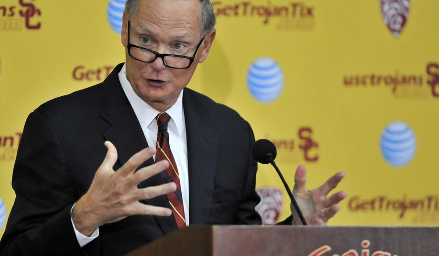 FILE - In this Oct. 13, 2015 file photo Southern California athletic director Pat Haden speaks with the media during a press conference after an NCAA college football practice in Los Angeles. Haden says he will retire on June 30, 2016. USC President Max Nikias made the announcement Friday, Feb. 5, 2016.  (AP Photo/Richard Hartog,File)