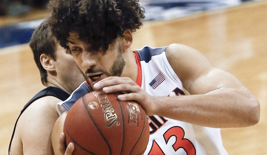 Virginia's Anthony Gill (13) goes to the hoop as Pittsburgh's Rafael Maia defends during the second half of an NCAA college basketball game, Saturday, Feb. 6, 2016, in Pittsburgh. Virginia won 64-50. (AP Photo/Keith Srakocic)