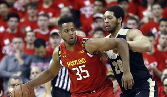 Maryland forward Damonte Dodd (35) drives against Purdue center A.J. Hammons in the first half of an NCAA college basketball game, Saturday, Feb. 6, 2016, in College Park, Md. (AP Photo/Patrick Semansky) ** FILE **