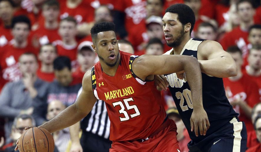 Maryland forward Damonte Dodd (35) drives against Purdue center A.J. Hammons in the first half of an NCAA college basketball game, Saturday, Feb. 6, 2016, in College Park, Md. (AP Photo/Patrick Semansky)