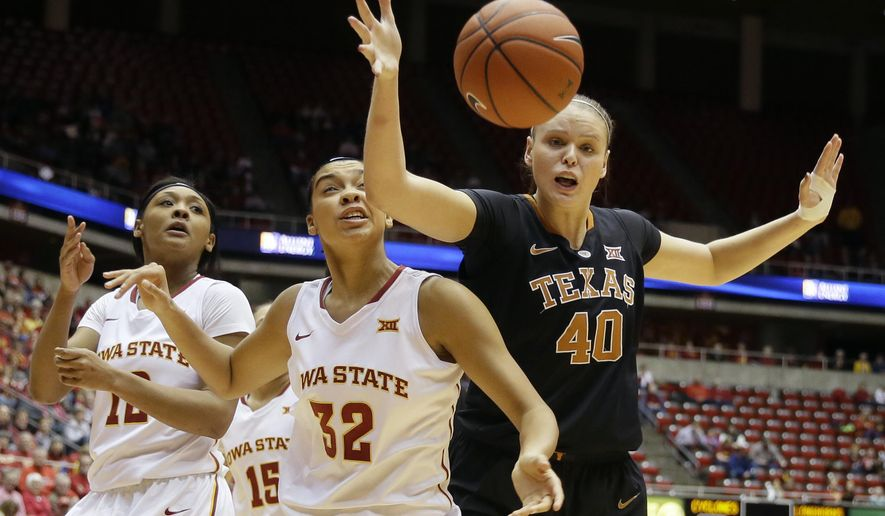 Texas center Kelsey Lang, right, fights for a loose ball with Iowa State's Meredith Burkhall, center, and Seanna Johnson, left, during the first half of an NCAA college basketball game, Saturday, Feb. 6, 2016, in Ames, Iowa. (AP Photo/Charlie Neibergall)