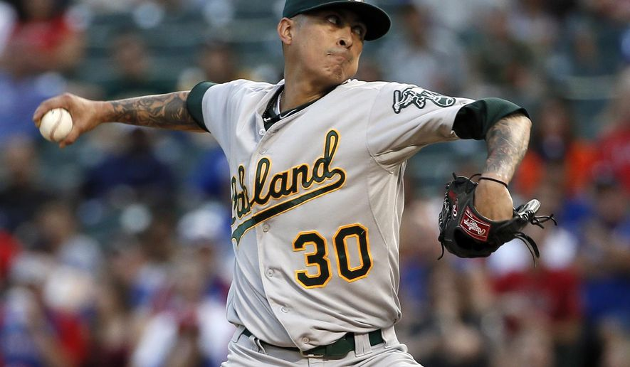 FILE - In this Sept. 11, 2015, file photo, Oakland Athletics starting pitcher Jesse Chavez works against the Texas Rangers during the first inning of a baseball game in Arlington, Texas. Chavez was awarded a $4 million salary on Saturday, Feb. 6, 2016, by arbitrators, improving players to 3-0 this year in cases that went to hearings. The Blue Jays, who traded for him last November from the A's, argued the 32-year-old right-hander should be paid $3.6 million. (AP Photo/Tony Gutierrez, File)