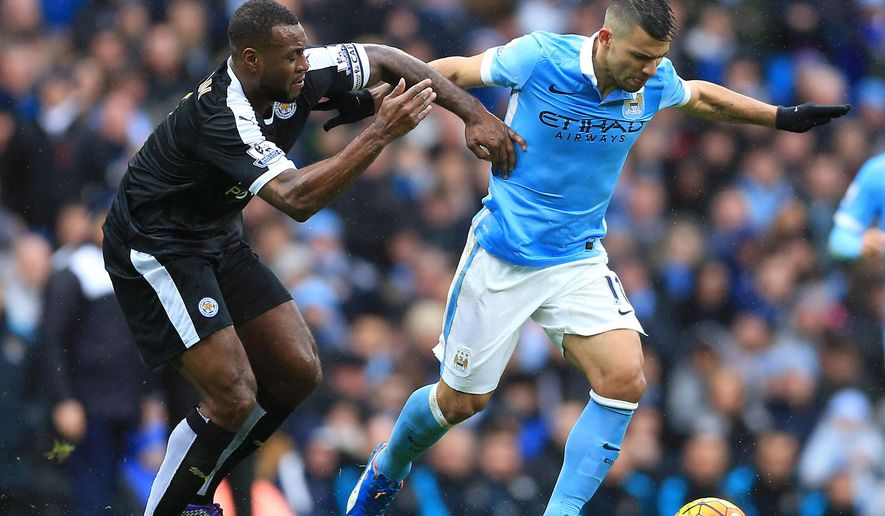 Manchester City's Sergio Aguero, right and Leicester City's Wes Morgan tussle for the ball during the English Premier League match at the Etihad Stadium, Manchester, England, Saturday Feb. 6, 2016. (Nigel French / PA via AP) UNITED KINGDOM OUT - NO SALES - NO ARCHIVES