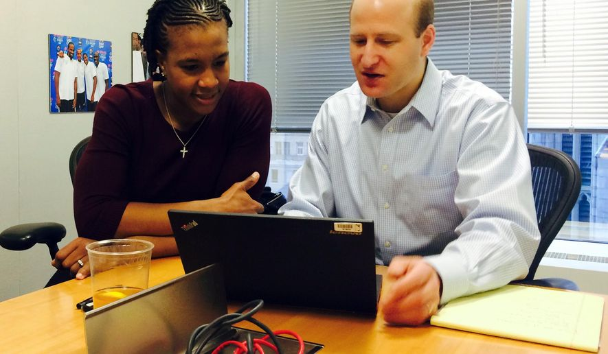 In this photo taken Jan. 27, 2016, WNBA player Tamika Catchings, who spent a a few weeks interning at the league office in New York, meets with NBA vice president of youth basketball development David Krichavsky, to discuss youth programs. (AP Photo/Doug Fineberg)