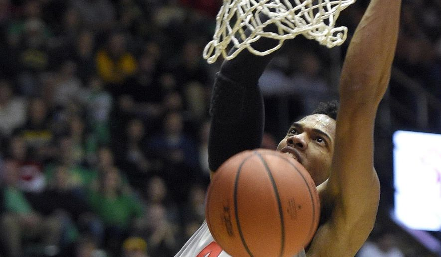 Dayton guard Charles Cooke (4) dunks during the first half of an NCAA college basketball game against George Mason, Saturday, Feb. 6, 2016, in Fairfax, Va. (AP Photo/Nick Wass)