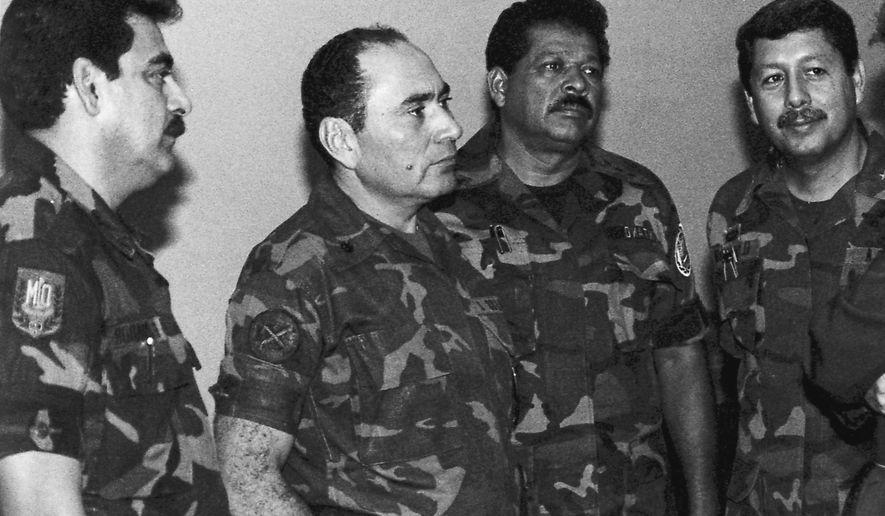 FILE - This July 1989 file photo shows, from left, Col. Rene Emilio Ponce, then head of the Salvadoran Armed Forces joint chiefs of staff, Rafael Humberto Larios, then El Salvador's defense minister, Col. Inocente Orlando Montano, then public safety vice minister and Col. Juan Orlando Zepeda, then defense vice minister, in an undisclosed location in El Salvador.  Salvadoran military implicated in the murder of six Jesuit priests in 1989 said they are innocent and that the real culprits have already been tried, convicted and amnestied. On Tuesday, Feb. 2, 2016, seven former soldiers put out a statement saying they are victims of political persecution and that they filed with the Supreme Court a writ of habeas corpus to avoid being captured and extradited to Spain. Ponce, left, died in El Salvador on May 2, 2011. (La Prensa Grafica via AP, File) EL SALVADOR OUT - NO PUBLICAR EN EL SALVADOR