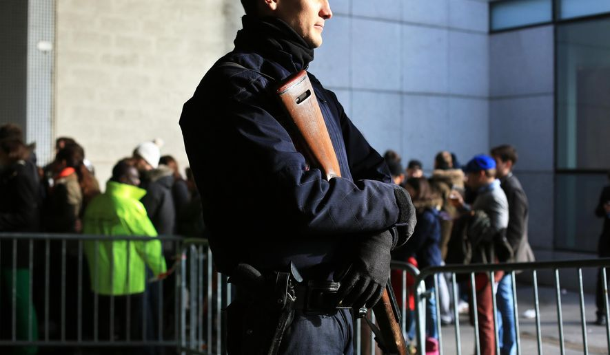 A French riot police officer stands guard at the entrance of the Stade de France prior to the Six Nations rugby match between France and Italy, in Saint Denis, north of Paris, Saturday, Feb. 6, 2016. Despite a marked increase in security checks, there was a calm and relaxed atmosphere outside Stade de France as fans arrived for the Six Nations rugby match between France and Italy on Saturday. It was the first event held at the national stadium since the deadly attacks that struck Paris of Nov. 13, when 130 people died and hundreds more were injured. (AP Photo/Thibault Camus)