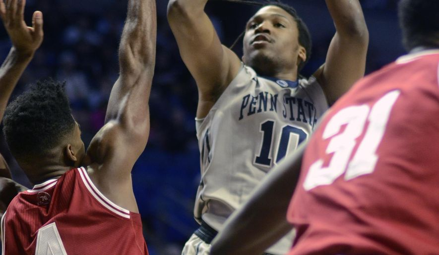 Penn State's Brandon Taylor (10) shoots over the head of Indiana's Robert Johnson (4) during the first half of an NCAA college basketball game in State College, Pa., Saturday, Feb. 6, 2016. (AP Photo/Ralph Wilson)