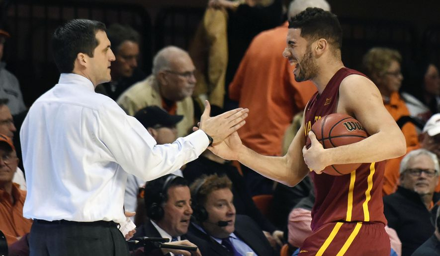 Iowa State guard Georges Niang, right, celebrates with head coach Steve Prohm following an NCAA college basketball game in Stillwater, Okla., Saturday, Feb. 6, 2016. Niang led Iowa State scoring with 18 points in the 64-59 win over Oklahoma State.(AP Photo/Brody Schmidt)